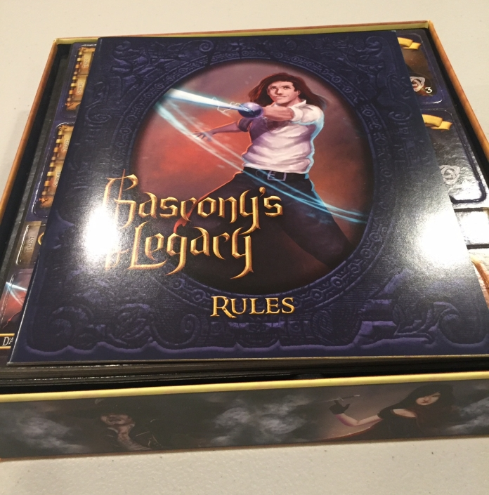 Unboxing! You see The Rulebook first thing!